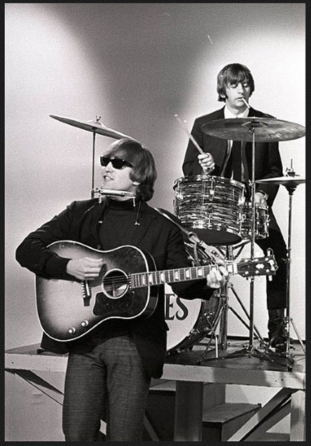 John Lennon with his 1962 Gibson J-160E guitar (The Beatles)