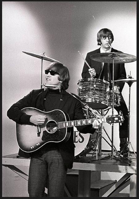 John Lennon with his 1962 Gibson J-160E guitar (The Beatles)