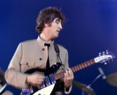 John Lennon with his 1963 Rickenbacker 325 guitar (The Beatles)