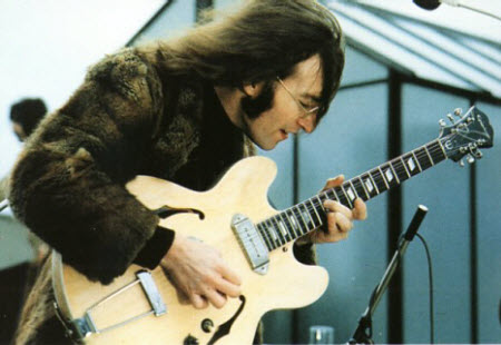 John Lennon with his 1965 Epiphone E230TD Casino guitar sanded (The Beatles)
