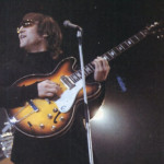 John Lennon with his 1965 Epiphone E230TD Casino guitar unsanded (The Beatles)