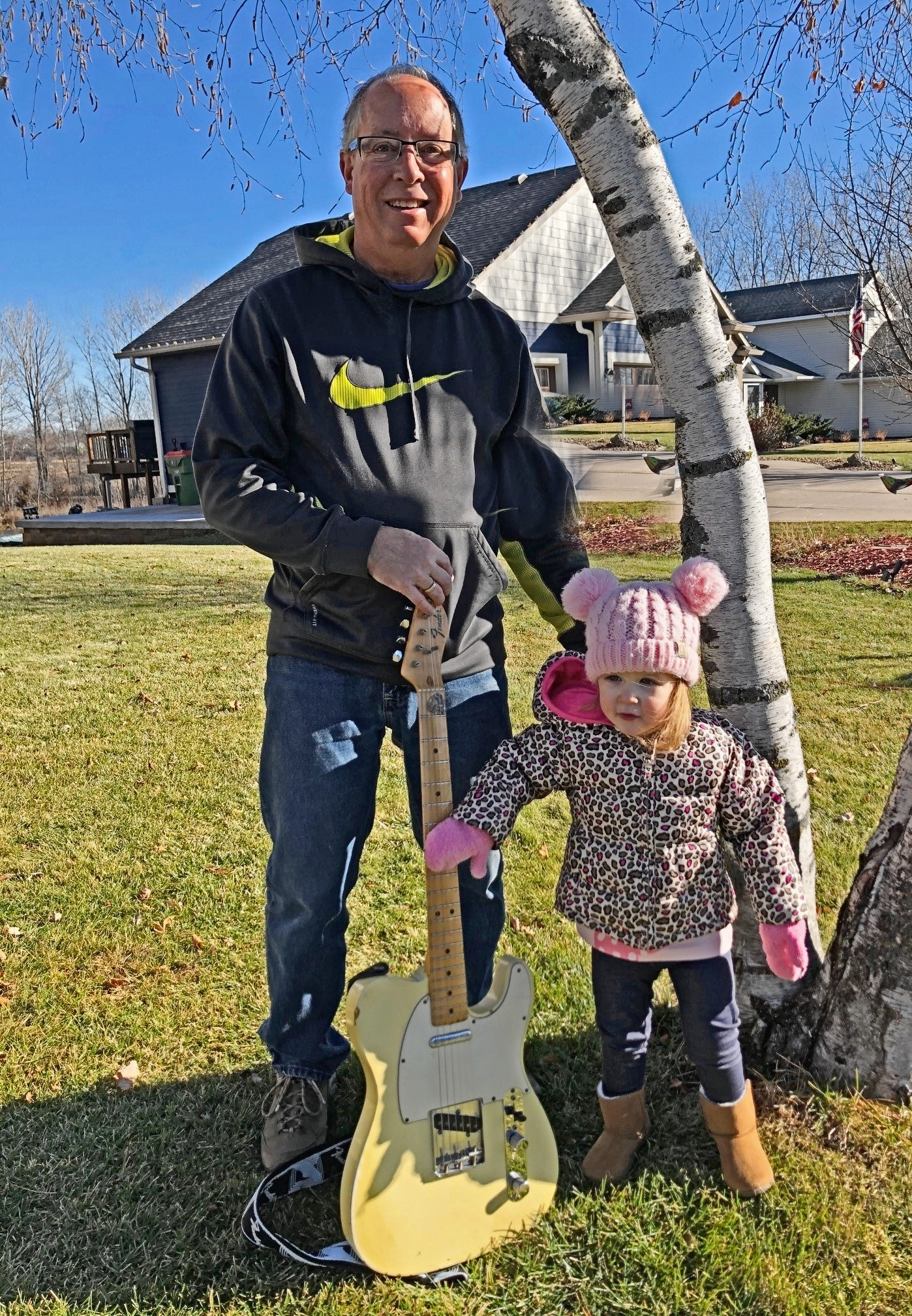 granddad, granddaughter and Fender telecaster