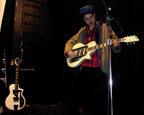 Cole from the Black Lips with his Airline Town & Country guitar