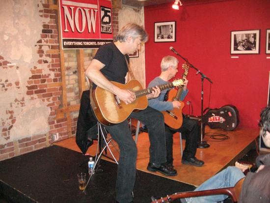 Dr. Dave Walker on stage with Tommy Emmanuel