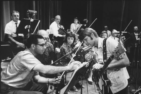 Glen Campbellin the studio with a Mosrite Celebrity III semi-acoustic