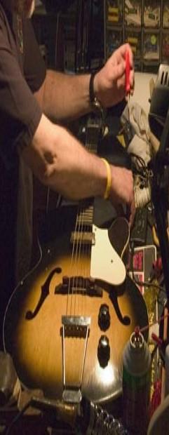 Guitar Tech Setting Up a Guitar