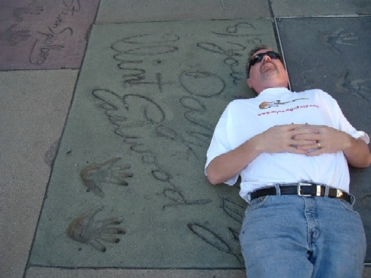 Hollywood tourist trek: Here I am having a quick snooze beside Clint EASTWOOD mark