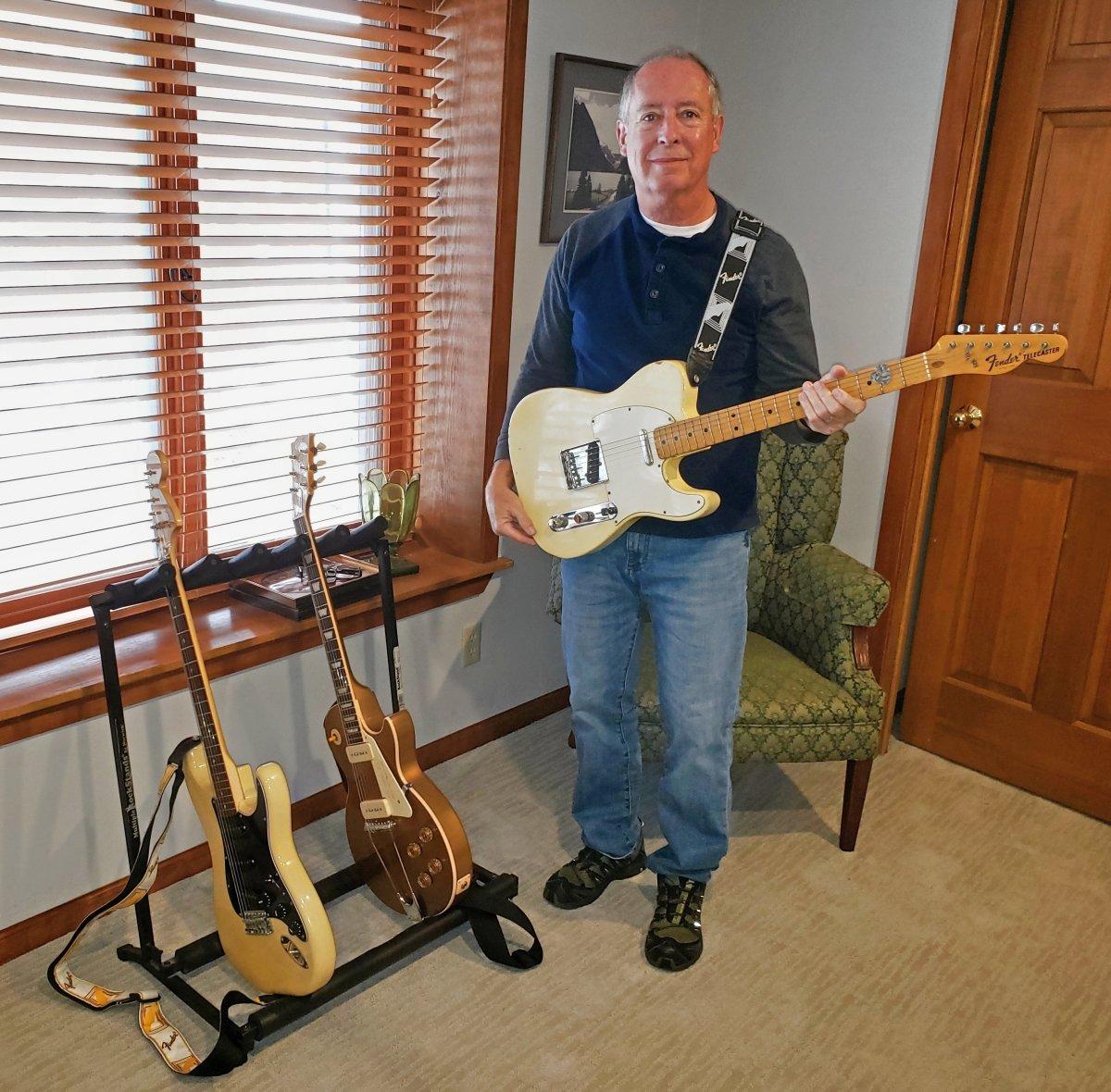 guitarist with guitars