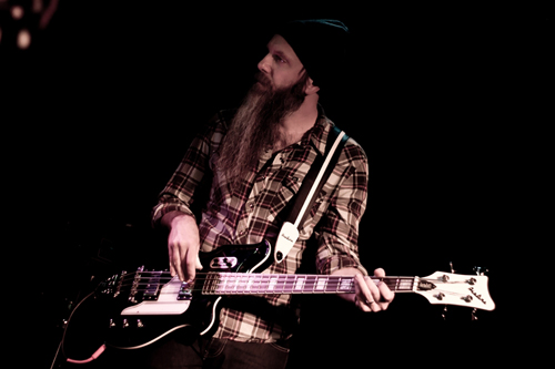 Lex Price (Silver Seas) with the Airline Map Bass Guitar