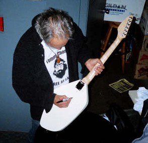 Tommy Chong signing my Eastwood Phantom Guitar