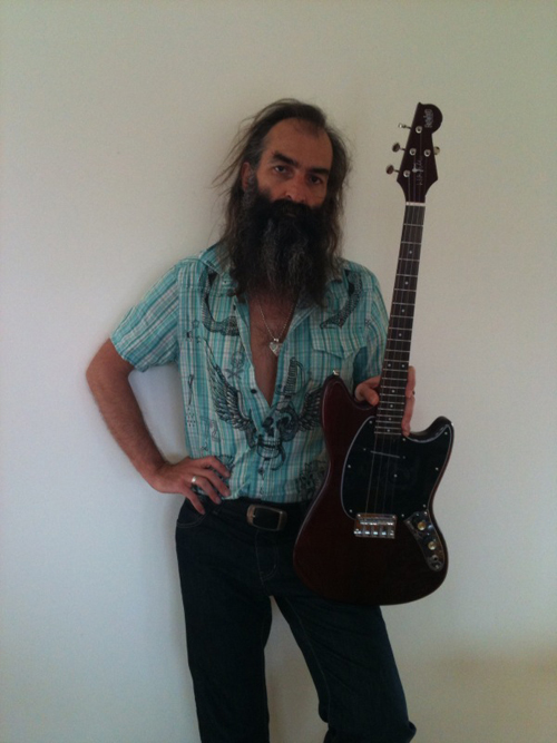 Warren Ellis with his signature Eastwood Tenor Guitar (Cherry Finish)