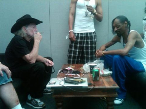 Willie Nelson & Snoop Dogg smoking backstage at the Glastonbury Music Festival (June 2010)
